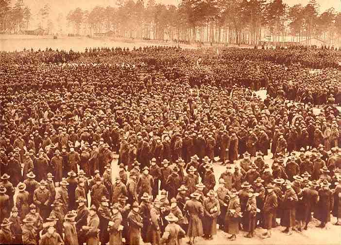 caption reads 'Practically the entire EMPIRE or Twenty-seventh Division composed exclusively of New York men, city and State assembled - these same troops a few months later, on the battle fields of France were helping to smash the famous Hindenburg line.If image fails to appear click on this area