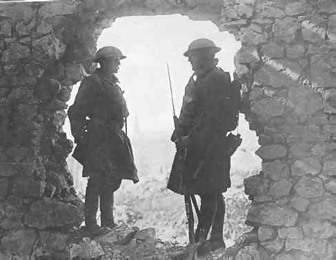 Two 107th soldiers stand guard amid the wreckage of a French chateau. Note the British canteen and the U.S M-1907 sling on the rifle..If image fails to appear click on this area