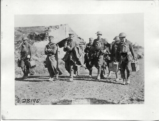Prisoners carrying wounded Doughboy, East of Ronssoy, Sept 29, 1918 during the Hindenburg Line Attack.If image fails to appear click on this area