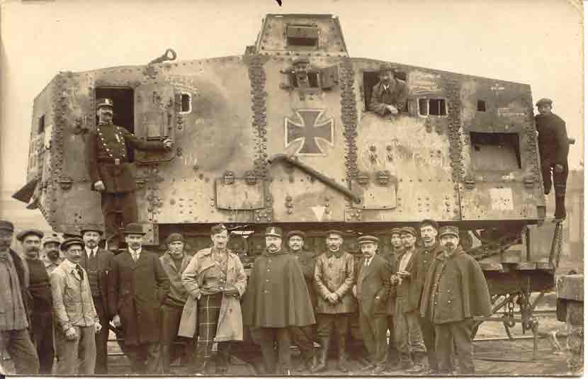 Captured German tank. Note the Scottish officer in front with tartan trousers
